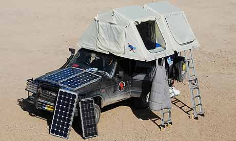 Overland in the sun team sets up camp in the partially solar powered Land Cruiser