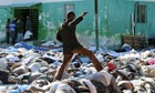 A man makes his way through bodies in Port-au-Prince, Haiti