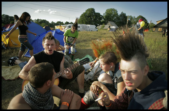 Teenage Hair: A group of teenagers with Mohicans at a festival campsite