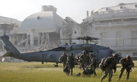 Soldiers from the 82nd Airborne land in Port-au-Prince, Haiti