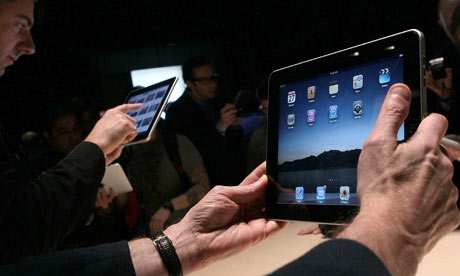 Apple's iPad in hand.