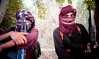 Taliban fighters in a Madrassa compound near the northern city of Kundoz in Afghanistan.