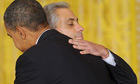 Rahm Emanuel is embraced by Barack Obama after announcing his resignation