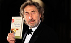 British author Howard Jacobson poses with his book after winning the 2010 Man Booker Prize