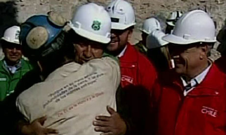 Bolivian president Evo Morales embraces Jorge Galeguillos, the 11th miner to be rescued in Chile
