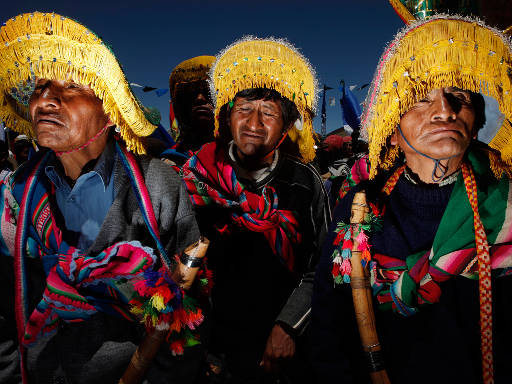 Aymara musicians in Uyuni, southern Bolivia, listen to a speech by President Evo Morales during a ceremony held as part of the 'Bolivia Changes, Evo Fulfils' government programme
