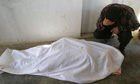 An Iraqi man cries over the body of his daughter Suad Abdullah, 14, in Falluja in April 2004