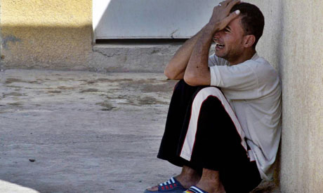 An Iraqi cries outside a hospital in the restive city of Baquba on 17 October 2006