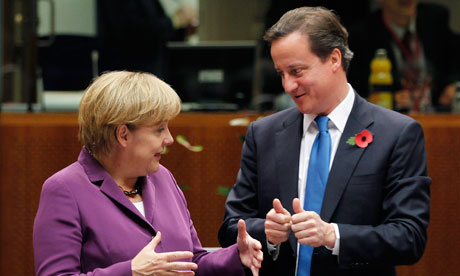 Angela Merkel and David Cameron at the EU summit in Brussels on 29 October 2010.