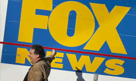 Man gestures at Fox News van