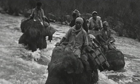 Still of film taken in 1942 by Gyles Mackrell of elephants crossing the Dapha river to rescue Britons fleeing the Japanese invasion of Burma.