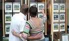 FIRST TIME PROPERTY BUYERS LOOKING AT ESTATE AGENTS WINDOW - 2004