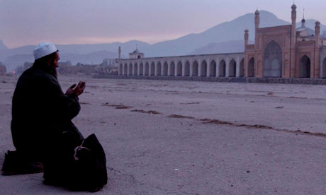 Evening prayers outside a mosque in Kabul. Today's attack killed 16 at a mosque in Takhar province.