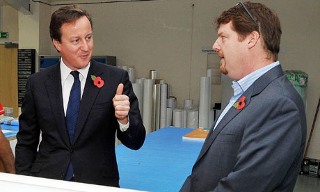 David Cameron talks to Oliver Bridgeman of Rocket Graphics Ltd, visit to Watford on 1 November 2010.