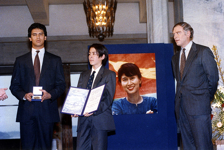 Aung San Suu Kyi was awarded a Nobel Peace Prize which was collected on her behalf by her two sons and husband