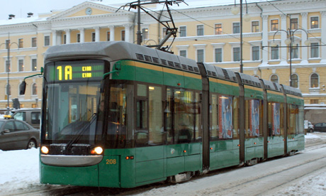 Helsinki's modern tram operating in snow
