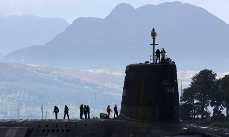 A Vanguard class nuclear submarine leaves Faslane naval base in Scotland