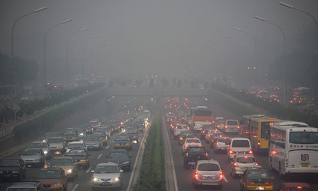 Traffic clogs Beijing as a heavy haze hangs over the city
