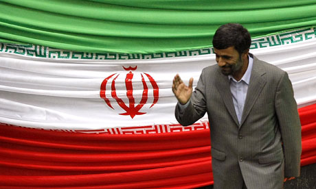 Mahmoud Ahmadinejad leaves the podium after being sworn back in as Iranian president