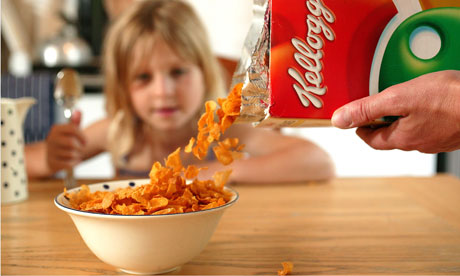 A child eating Kelloggs cornflakes