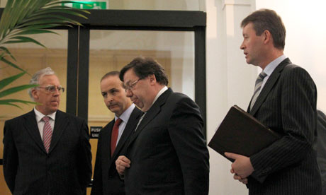 Irish Prime Minister Brian Cowen leaves a news conference