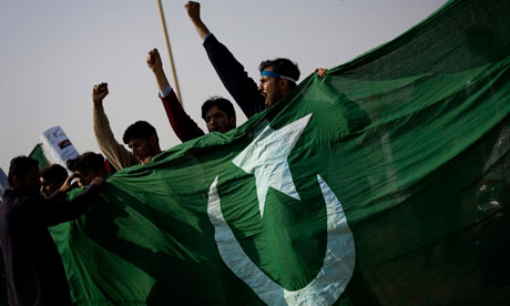 Islamist students hold Pakistan's national flag in Islamabad