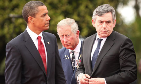 Gordon Brown (right) with Barack Obama (left) as the Prince of Wales at a French D-day ceremony