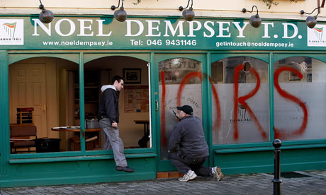 A glazier works on the damage to transport minister Noel Dempsey's constituency office in Trim