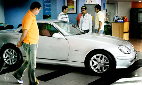Young Indians inspect a Mercedes Benz