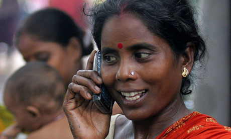 A Kolkata slum dweller with a mobile  |  Photograph: Jayanta Shaw/Reuters/Corbis; courtesy - guardian.co.uk, Wednesday 24 November 2010 11.22 GMT  |  Click for image.