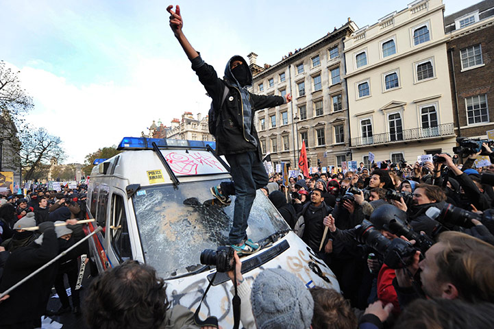Student protests: Protesters target a police van during a demonstration in Westminster London