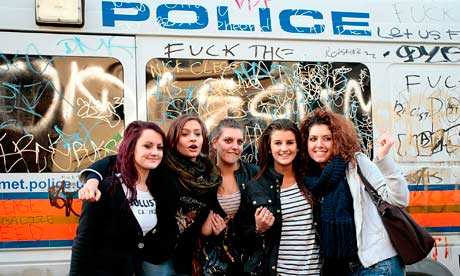 Students in front of police van