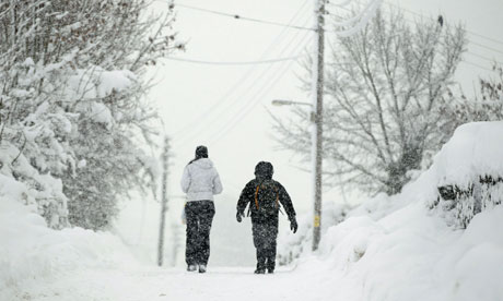 Child and adult walk in the snow