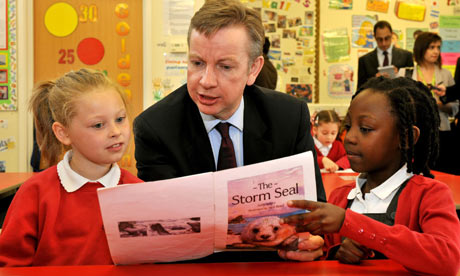 Education secretary Michael Gove reading with primary school pupils in Edmonton, north-east London
