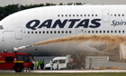 Firefighters spray the Qantas A380 Airbus