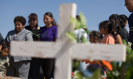 Relatives of Francisco Arreola attend his funeral in Ciudad Juárez, Mexico, ...