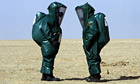 British soldiers wearing protective chemical suits in 2003