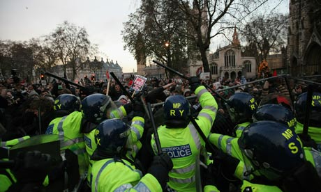 Police and student protesters clash in Parliament Square