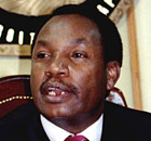 Henry Kosgey speaks to journalists at a news conference.