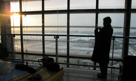 Snow at Heathrow. Chancellor George Osborne was unable to return to the UK because of the weather