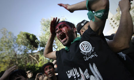 A Lebanese Shia man takes part in Ashura commemorations