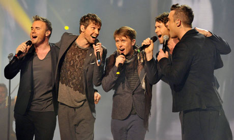 Take That perform on The X Factor final.