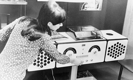 A fashionably designed sound system with a radio tuner and a record player