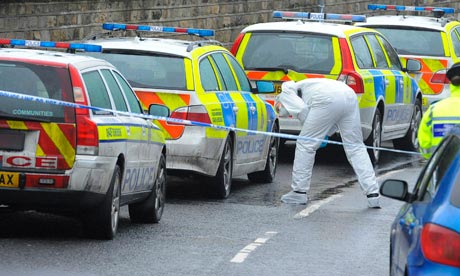 Police officers attend the scene of a shooting in Kirkheaton