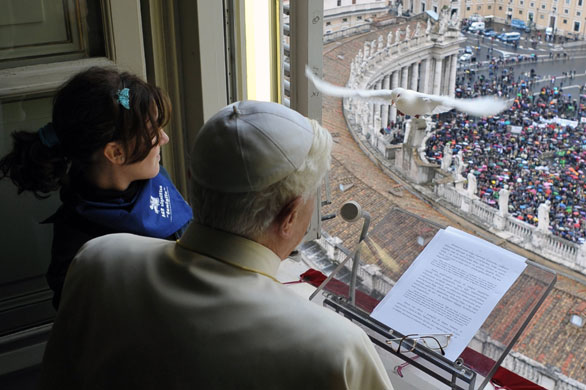 Dove flies back in Pope's window after being released.