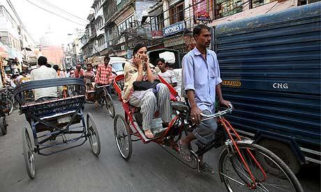 A woman travels in a rickshaw in New Delhi, India