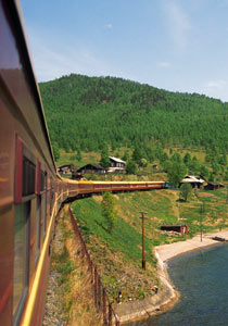 Trans-Siberian express train passes by Lake Baikal