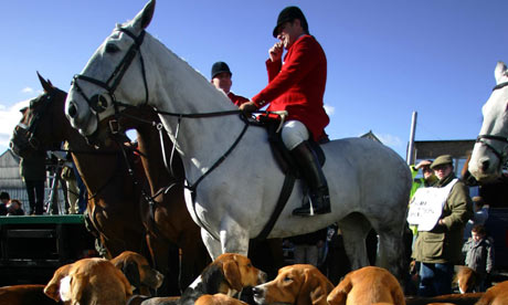 Foxhunting: hounds and huntmen.