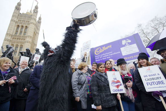 cadbury protest: A protester dressed as a gorilla bangs a drum outside parliament