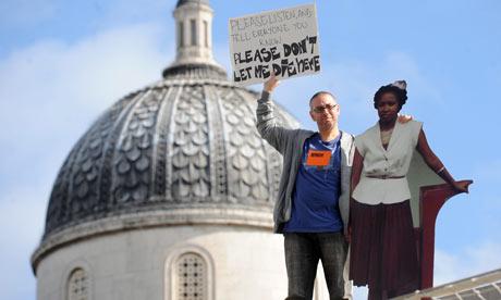 Brian Capaloff protests Linda Carty's innocence on the fourth plinth in Trafalgar Square.